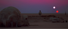 This Image of Tatooine taken from the movie Star Wars clearly shows that the planet orbits a binary system of stars. Kepler-16b resembles this planet in size and also orbits a bright sun-like star and dimmer red dwarf.
