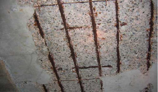 Figure 4: Spalling of concrete due to reinforcing bar corrosion (Structure)
